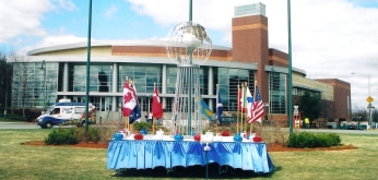 Curling stones and flags of the competing countries outside the Tsongas